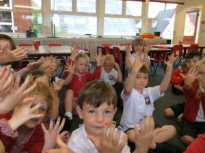 We had coloured sticky dots on our fingers and traced the mazes.